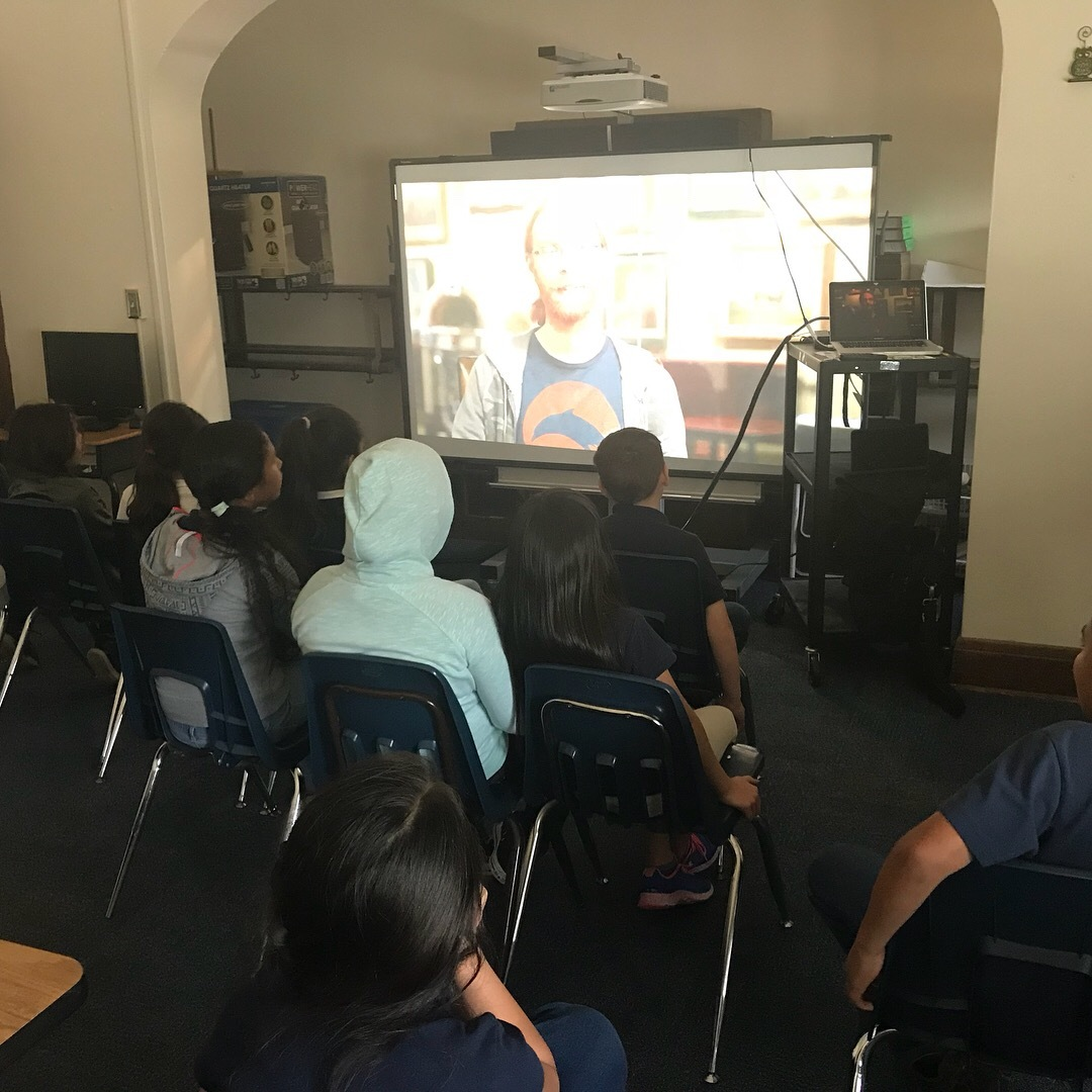 Students watching video on Code.org