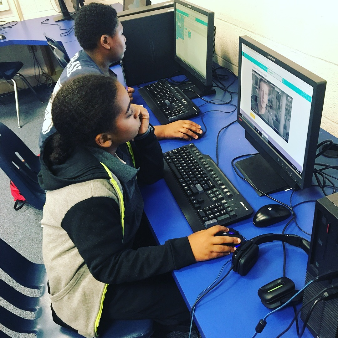 Young Men Leadership Academy students exploring computer science
